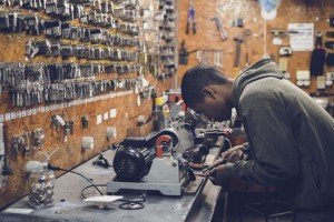 teen working with tools in garage