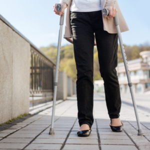 disabled woman walking with forearm braces