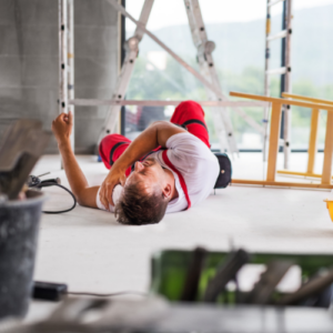 injured-worker-lying-on-ground-in-pain
